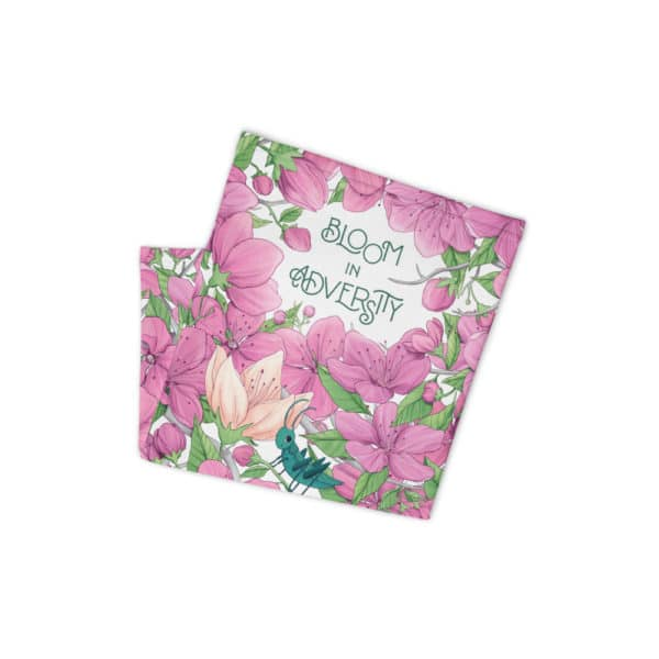 """Affirmask - the Empowered Princess face mask - """"bloom in adversity"""" folded laying flat on white background"""
